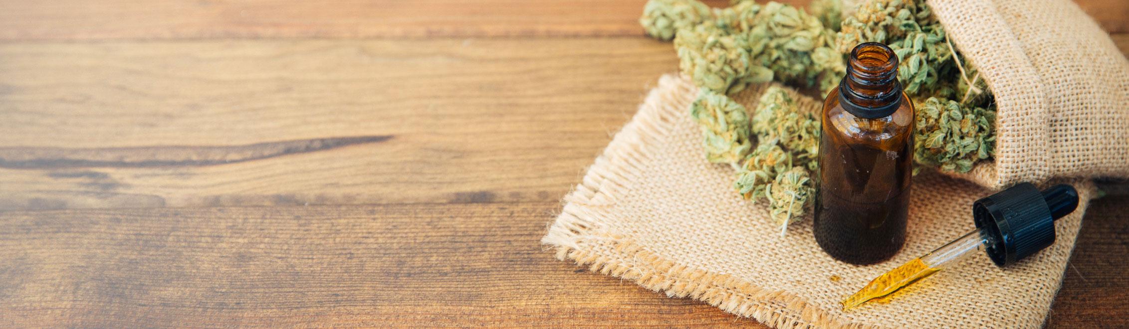 Image on About page medical marijuana CBD Oil on wood table