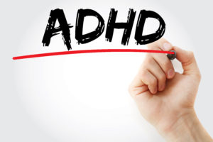 Image of hand writing ADHD on Medical Marijuana & ADHD page