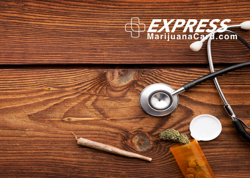Image of wooden table with stethoscope and medical marijuana